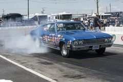 Chevelle smoke show on the track Stock Images