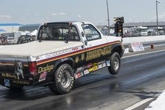 Dodge pickup truck making a wheelie on the track Stock Photography