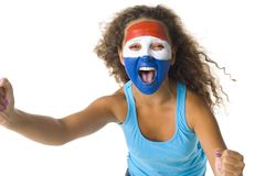 We are the champions!. Young screaming Croatian or Dutch sport's fan with painted flag on face and with clenched fist. Front view. Looking at camera, white Stock Photo