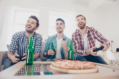 We are champions! Bachelor men`s life. Low angle of three joyful stock photos