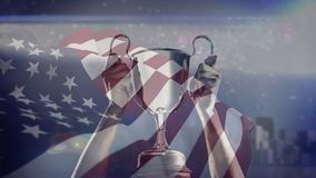 American flag and trophy