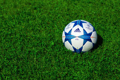 Champions league ball. ZAGREB , CROATIA - 13 AUGUST 2015 - close up of European champions league official football from Adidas on the grass field , product shot stock photography
