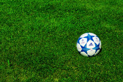 Champions league ball. ZAGREB , CROATIA - 13 AUGUST 2015 - close up of European champions league official machball football from Adidas on the grass field stock image