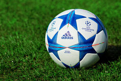 Champions league ball. ZAGREB , CROATIA - 13 AUGUST 2015 - close up of European champions league official machball football from Adidas on the grass field stock images