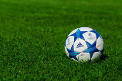 Champions league ball. ZAGREB , CROATIA - 13 AUGUST 2015 - close up of European champions league 2015-2016 official machball football from Adidas on the grass royalty free stock images