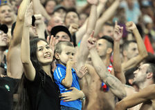 CHAMPIONS LEAGUE: STEAUA BUCHAREST-DINAMO TBILISI. A mother and her child cheering for their favourite team during the Champions League qualifier game between stock images
