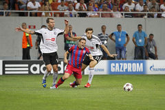 Champions League: Steaua Bucharest - Legia Warsaw. Legias Jakub Wawrzyniak(L) and Michal Zyro (R) and Steauas Adrian Popa (centre) pictured in action during the Stock Images