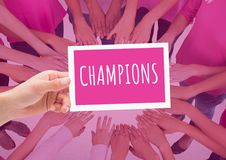 Champions Text on card in circle of hands together for breast cancer awareness stock photography
