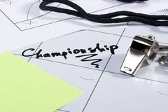 Championship. A silver whistle laying on a calendar with the word Championship on it Stock Photo