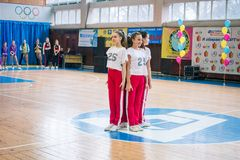 Championship of the city of Kamenskoye in cheerleading among solos, duets and teams. Kamenskoye, Ukraine - March 9, 2017: Championship of the city of Kamenskoye Royalty Free Stock Images