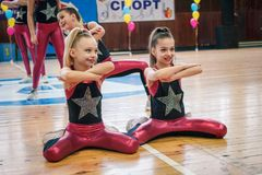 Championship of the city of Kamenskoye in cheerleading among solos, duets and teams. Kamenskoye, Ukraine - March 9, 2017: Championship of the city of Kamenskoye Stock Photo