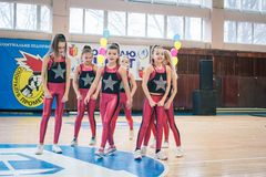 Championship of the city of Kamenskoye in cheerleading among solos, duets and teams. Kamenskoye, Ukraine - March 9, 2017: Championship of the city of Kamenskoye Royalty Free Stock Photo
