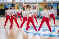Championship of the city of Kamenskoye in cheerleading among solos, duets and teams. Kamenskoye, Ukraine - March 9, 2017: Championship of the city of Kamenskoye Stock Photos