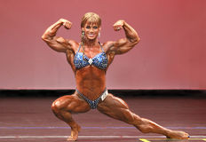 Championship Form. Cathy LeFrancois from Quebec, Canada flashes the powerful form which propelled her to victory at the 2009 NY Pro Womens Bodybuilding Stock Photography