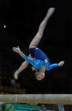 Championship on sporting gymnastics. A sportswoman from the Russian combined team Zmeu Alena on a sporting gymnastics executes exercise on a log Stock Photography