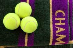 Championship Towel. Three tennis balls on a purple and gold towel stock photo