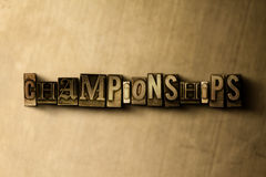 CHAMPIONSHIPS - close-up of grungy vintage typeset word on metal backdrop Stock Image