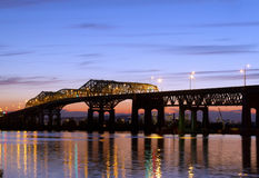 Champlain bridge. Camplain bridge at dusk with the Montreal skyline in the background Stock Images