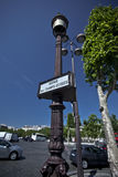 Champs Elisees. View of a sign on  a street lamp of the Champs Elisees Avenue in Paris Stock Photos