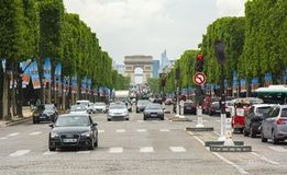Champs Elysee avenue and Triumphal arch Arc de Triomphe in Paris, France Stock Image