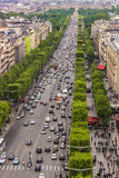 Champs Elysees. Paris, France - May 19, 2012: Overlooking Champs Elysees avenue from the top of Arch of Triumph. Daily view of the busy street full of people and Royalty Free Stock Images
