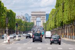 The Champs-Elysees with the Arc de Triomphe in central Paris. PARIS,FRANCE - JULY 29,2017 : The Champs-Elysees with the Arc de Triomphe in central Paris on the Royalty Free Stock Photos