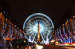 The Champs-Elysees avenue. And the ferris wheel on Concorde Square illuminated for Christmas Stock Photography