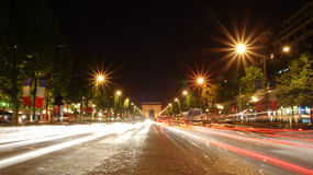 Champs-Elysees avenue. At night with the Triumphal Arch in the background stock photography