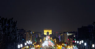 Champs-Elysees Avenue with the Arc de Triomphe in Paris France. At night Stock Photography