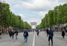 Champs Elysees avenue closed to car traffic - Paris. Paris, France - May 5, 2019: People wandering on Champs Elysees avenue with Arc de triomphe in background stock photo