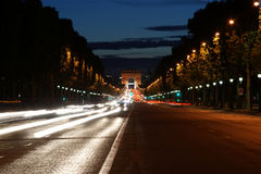 Champs-Elysees avenue at night. With the Triumphal Arch in the background, Paris, France Stock Images
