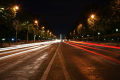 Champs-Elysees avenue at night. With the Triumphal Arch in the background, Paris, France Stock Photography
