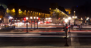 Champs-Elysees and Concorde square traffic night. Landmark and touristic spot: Champs-Elysees avenue and Concorde square in Paris, France, at night with royalty free stock photography