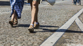 Champs Elysees on Foot. Paris- August 6,2017: Deatail image of the legs of an unidentified couple walking on the famous Boulevard Champs Elysees closed for car stock photo