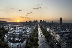 Champs Elysees and La Defense. The Champs Elysees and La Defense at Sunset royalty free stock image