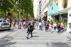 Champs-elysees - Paris. PARIS, Aug. 22 2014 : Local and tourists stroll at des Champs-elysees Avenue des Champs Elysees is the biggest and most famous and stock photography