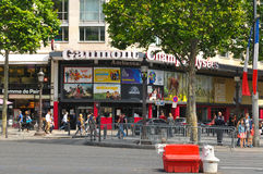 Champs Elysees. Paris, France - July 8, 2015: Groups of tourists walk across the famous Champs Elysees boulevard in central Paris, France Stock Images