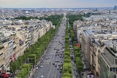 Champs-Elysees in Paris, France. Paris, France - May 13, 2018: View down the Avenue des Champs-Elysees towards de Louvre Museum and a giant ferris wheel on Place stock photos