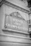 Champs Elysees. Paris, France - Champs Elysees street sign. One of the most famous streets in the world. Black and white toned photo royalty free stock image
