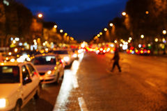 Champs-Elysees in Paris at night. Crative out of focus picture of traffic on the Champs-Elysees in Paris at night royalty free stock photography