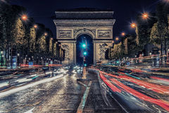 Champs-Elysees in Paris. Champs-Elysees by night near the  Arc de Triomphe Stock Photos