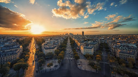 Champs-Elysees in Paris. Sunset over Champs-Elysees and La Defense in Paris royalty free stock photography