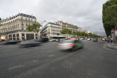 The Champs Elysees in Paris. The traffic in the Champs Elysees in Paris royalty free stock photography