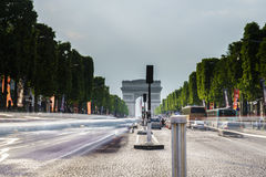 Champs Elysees, Paris. Very high resolution, 42.2 megapixels. Vehicles travel along avenue Champs Elysees - one of a famous touristic places in Paris, France stock photography