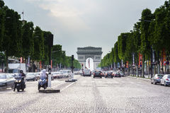 Champs Elysees, Paris. Very high resolution, 42.2 megapixels. Vehicles travel along avenue Champs Elysees - one of a famous touristic places in Paris, France royalty free stock photos