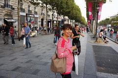 At the Champs Elysees. Photo of latina at the champs elysees in paris france on 9/6/14. This avenue is large and features many shops and restaurants stock image