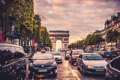 Champs-Elysees street. Full of cars. Arch of triumph visible. Paris, France royalty free stock photography
