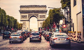Champs-Elysees street. Full of cars. Arch of triumph visible. Paris, France royalty free stock photo