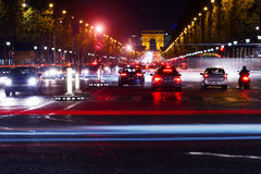 Champs-Elysees traffic night. Landmark and touristic spot: Champs-Elysees avenue in Paris, France, at night with streetlights, cars and intensive traffic Royalty Free Stock Images