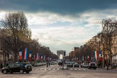 Champs Elysees and the Triumphal Arch in a cold winter day in Paris. PARIS, FRANCE - MARCH, 2018: Champs Elysees and the Triumphal Arch in a cold winter day in royalty free stock image